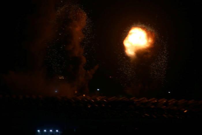Asap dan api terlihat setelah serangan udara Israel di Jalur Gaza selatan